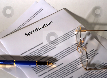 Specification stock photo, A specification sheet used for building or other works. With pen and glasses by Paul Phillips