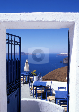 Doorway to peace stock photo, Gate through to a bar in Santorini, Greece by Paul Phillips