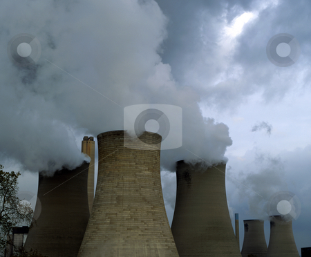 Cooling towers stock photo, Several cooling towers with steam and cloud by Paul Phillips
