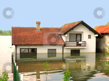 Flood - house in water stock photo, House with red tailed roof in river by Julija Sapic