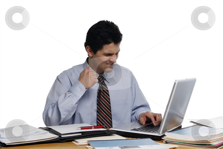 Darn! stock photo, Businessman sitting at a laptop with his hand clenched in a fist and his face scrunched up in anger.  Shot vertical isolated on white. by Orange Line Media
