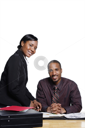 Smiling Businesspeople stock photo, Male and female businesspeople smiling at the camera. Isolated on white. by Orange Line Media