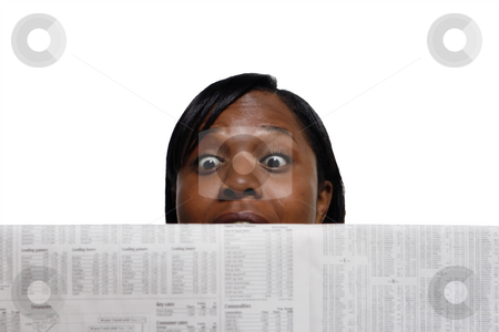 Surprised Woman - Horizontal stock photo, Woman reading the newspaper with a very surprised look on her face by Orange Line Media