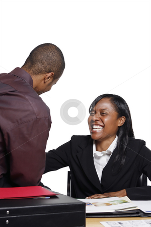 Businesspeople Laughing stock photo, Male and female business colleagues laughing at their desk over a joke. Isolated against a white background. Vertically framed shot. by Orange Line Media