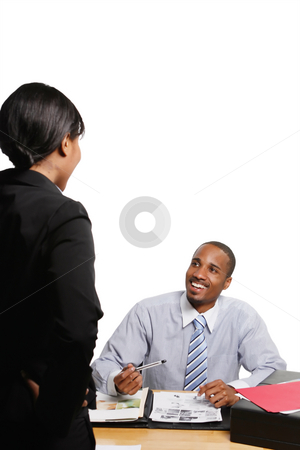 Smiling Business Colleagues - Vertical stock photo, Male and female business colleagues chatting and smiling. Vertical shot, isolated against a white background by Orange Line Media