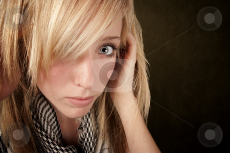 Close up of pretty blonde woman stock photo, Close up of blonde girl focusing on her eye by Scott Griessel