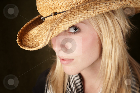 Pretty blonde teenager in a cowboy hat stock photo, Blonde teenager wearing a straw cowboy hat by Scott Griessel