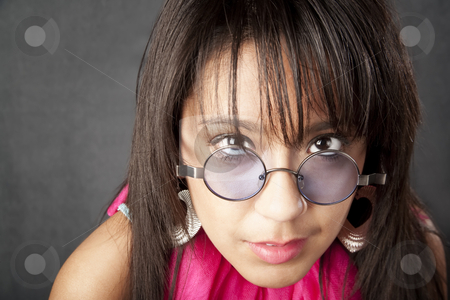 Pretty Woman stock photo, Close up portrait of a pretty brunette woman looking over her glasses by Scott Griessel