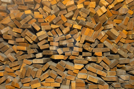 Wood ends stock photo, Close-up of the ends of different sizes of cut wood, piled up at a sawmill. Slight wide-angle effect makes pieces appear to radiate from centre. by Alistair Scott