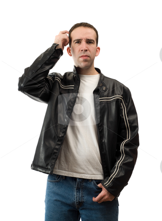 Confused Man Scratching Head stock photo, A confused young man is scratching his head, isolated against a white background by Richard Nelson