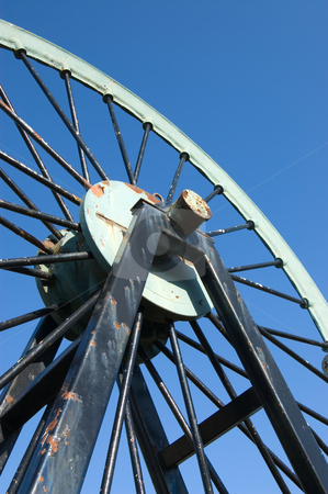 Pulley Wheel stock photo, Pulley wheel from a coal mine against at blue sky by Peter Cox