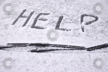 Snow covered car windscreen stock photo, Snow covered car windscreen with the word help written in the snow by Peter Cox