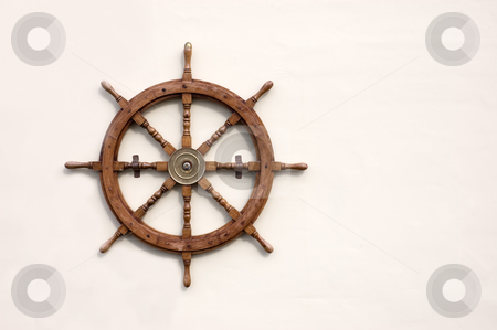 Ships Wheel stock photo, Ornamental ships wheel mounted on a wall by Peter Cox