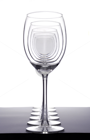 Empty wineglasses stock photo, Row of empty wineglasses by Paul Turner