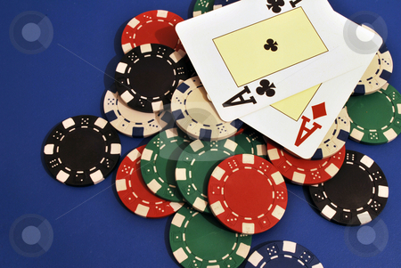 Poker Chips stock photo, Casino chips on a blue background and ace card in Vegas by Tudor Antonel adrian
