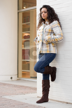 Young Indian Woman  stock photo, A young Indian woman posing outdoors in an urban setting. by Todd Arena
