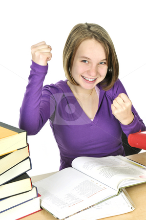 Teenage girl studying stock photo, Happy teenage girl studying at the desk by Elena Elisseeva