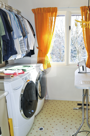 Laundry room stock photo, Laundry room with modern washer and dryer by Elena Elisseeva