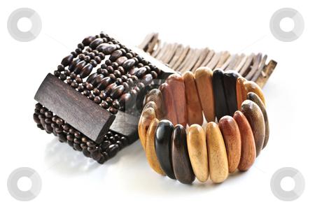 Wooden bracelets stock photo, Wooden bracelets isolated on white background by Elena Elisseeva
