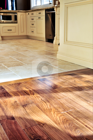 Hardwood  and tile floor stock photo, Hardwood and tile floor in residential home kitchen and dining room by Elena Elisseeva