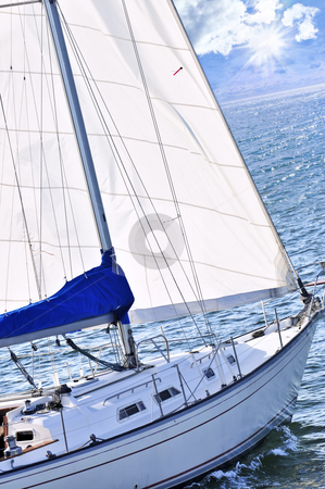 Sailboat stock photo, Sailboat with white sail sailing on a sunny day by Elena Elisseeva