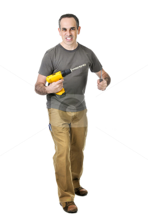 Handyman with a drill and screwdriver stock photo, Confident handyman holding a drill and screwdriver by Elena Elisseeva