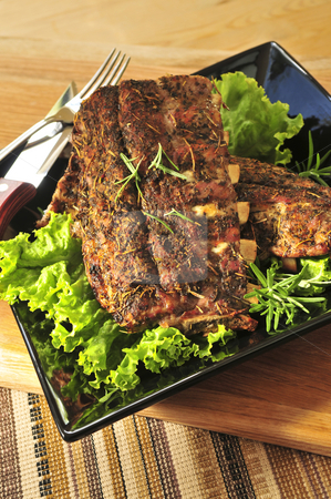 Spare rib dinner stock photo, Plate of spare ribs and greens for dinner by Elena Elisseeva