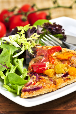Vegetarian pizza with salad stock photo, Vegetarian meal of vegetable pizza and green salad by Elena Elisseeva