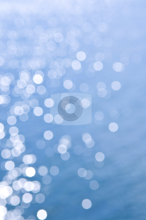 Blue water background stock photo, Out of focus bokeh background of blue water with sun reflections by Elena Elisseeva