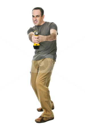Handyman with a drill stock photo, Fierce handyman aiming his cordless drill like a gun by Elena Elisseeva