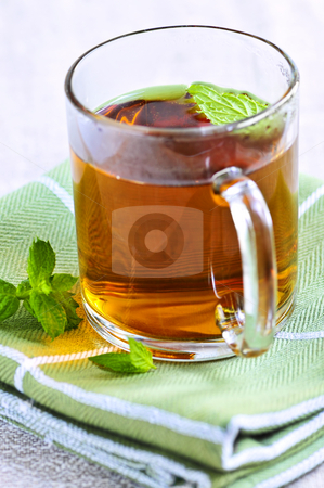 Mint tea stock photo, Cup of fresh herbal mint tea with peppermint leaves by Elena Elisseeva