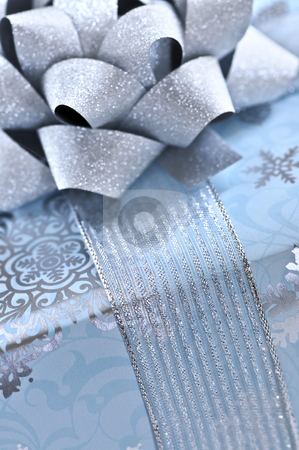 Christmas gift box stock photo, Christmas gift box wrapped in blue paper with silver ribbon close up by Elena Elisseeva