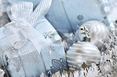 Christmas gift boxes stock photo, Wrapped gift boxes with silver Christmas ornaments by Elena Elisseeva