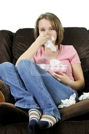 Teenage girl with a cold stock photo, Teenage girl with a cold sitting in a chair with tissue box by Elena Elisseeva