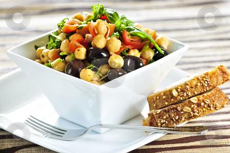 Vegetarian chickpea salad stock photo, Vegetarian meal of chickpea or garbanzo beans salad by Elena Elisseeva