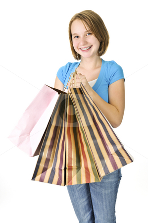 Teenage girl with shopping bags stock photo, Happy teenage girl with lots of shopping bags by Elena Elisseeva