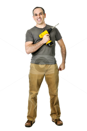 Handyman with a drill stock photo, Smiling handyman ready to work holding a drill by Elena Elisseeva