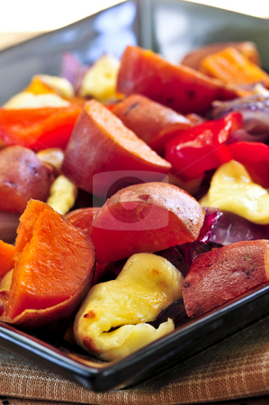 Roasted sweet potatoes stock photo, Vegetarian dish of roasted yams with cheese and peppers by Elena Elisseeva