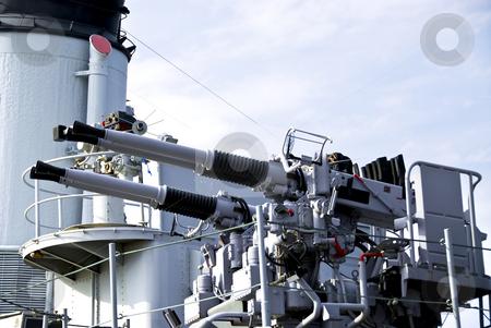 Guns on a ship stock photo, Large white guns on a military naval vessel by Elena Elisseeva