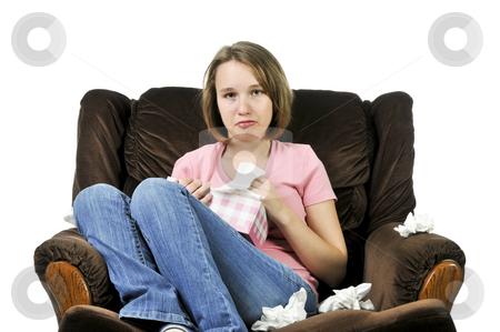 Teenage girl with a cold stock photo, Teenage girl with a cold sitting in a chair with tissue box by Elena Elisseeva