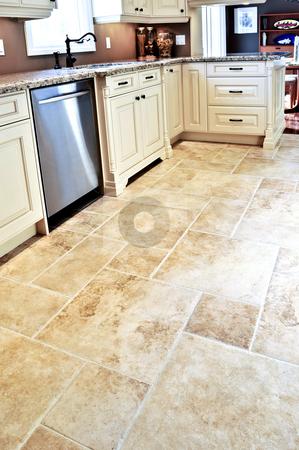 Tile floor in modern kitchen stock photo, Ceramic tile floor in a modern luxury kitchen by Elena Elisseeva