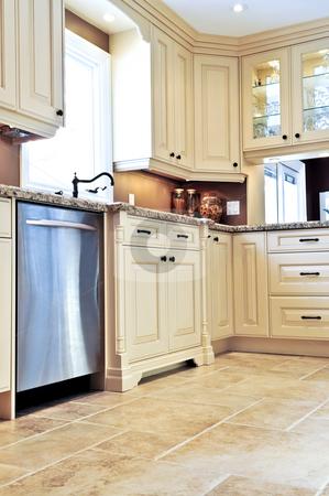 Modern kitchen with tile floor stock photo, Modern luxury kitchen with ceramic tile floor by Elena Elisseeva