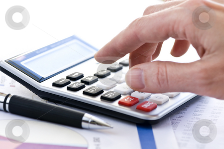 Tax calculator and pen stock photo, Typing  numbers for income tax return with pen and calculator by Elena Elisseeva