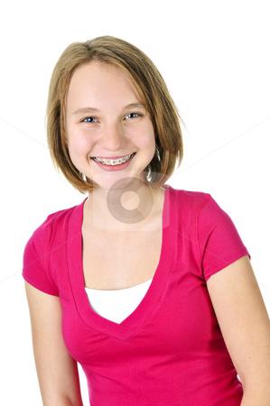 Teenage girl smiling with braces stock photo, Isolated pretty teenage girl with braces smiling by Elena Elisseeva