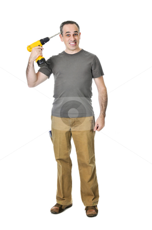 Handyman with a drill stock photo, Frustrated handyman putting a drill to his head by Elena Elisseeva