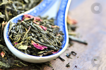 Loose green tea stock photo, Green tea loose dry leaves in a spoon by Elena Elisseeva