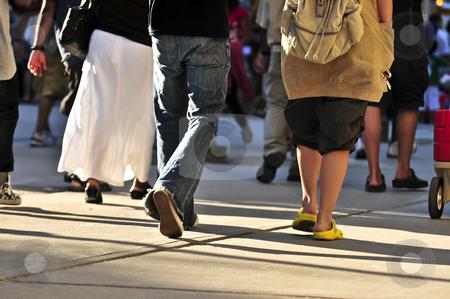 Walking people stock photo, Crowd of people walking on a street by Elena Elisseeva