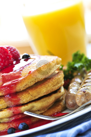 Pancakes breakfast stock photo, Breakfast of buttermilk pancakes with sausages and fresh berries by Elena Elisseeva