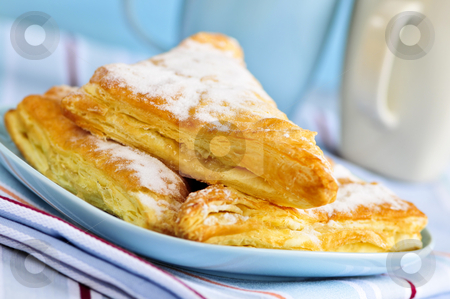 Apple turnovers pastries stock photo, Apple turnovers pastries with coffee cups in the background by Elena Elisseeva