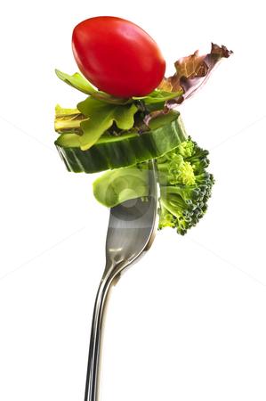Fresh vegetables on a fork stock photo, Fresh vegetables on a fork isolated on white background by Elena Elisseeva